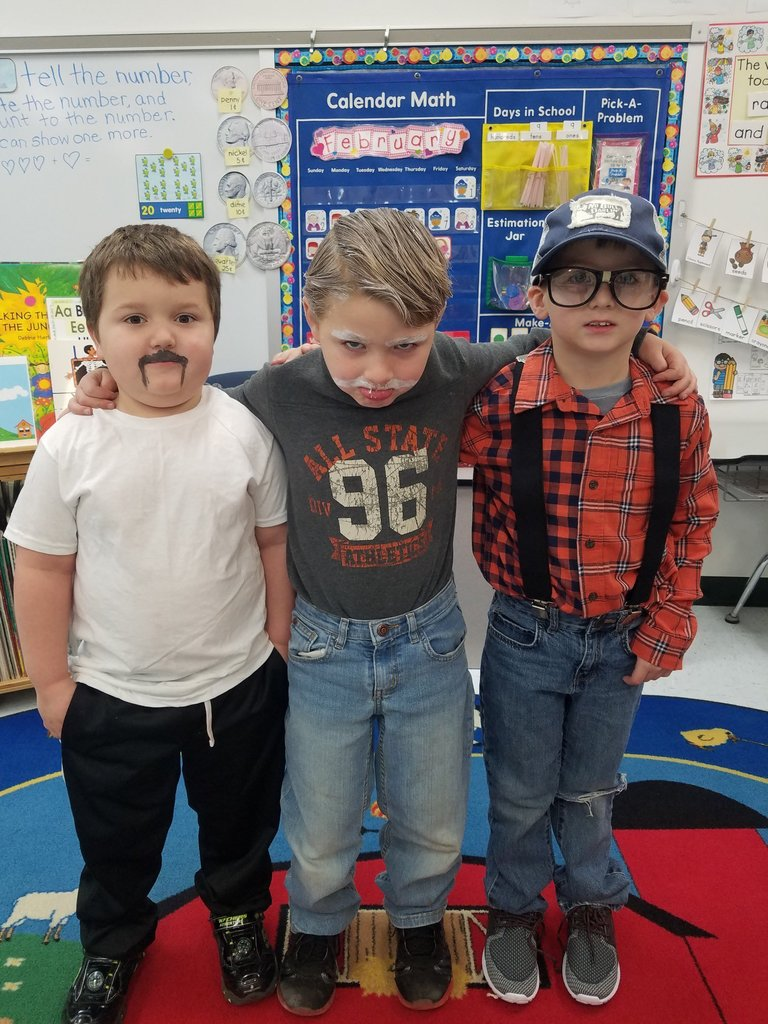 three students dressed up